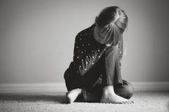 Sad girl. Black and white image of a girl who seems sad Royalty Free Stock Photos