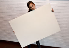 Sad girl with blank poster Royalty Free Stock Photo