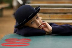 Sad girl in blue hat and cardigan Royalty Free Stock Photography