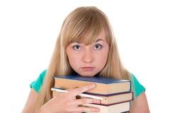Sad girl with the books Stock Photos