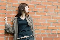 Sad girl at brick walls Royalty Free Stock Images