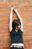 Sad girl at brick walls Stock Photography