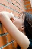 Sad girl at brick walls Royalty Free Stock Photos