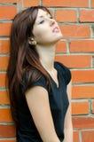 Sad girl at brick walls Stock Images