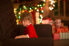 Sad girl on a brown chair, Christmas or New Year concept Stock Photo