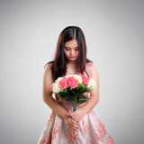 Sad girl with bunch of roses stock image