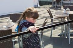 Sad girl in cafe Royalty Free Stock Image