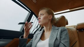 Sad girl calling to lover in taxi. Tired businesswoman making phone call in car