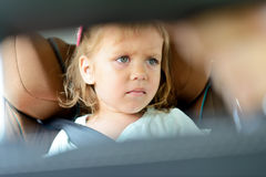 Sad girl in car Royalty Free Stock Images