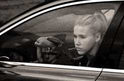 Sad girl in the car Stock Images