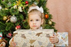 The sad girl with a Christmas present Stock Photo