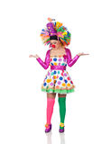 Sad girl clown with a big colorful wig Royalty Free Stock Image