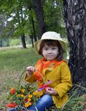 A basket of flowers forest childhood beauty portrait spring senior grass people tree plant green person flower little happy outdoo Stock Image