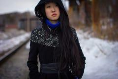 Sad girl in coat Stock Photo