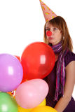 Sad girl with colored baloons. Isolated on the white stock photo