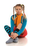 Sad girl in colour clothes Stock Image