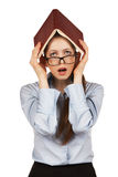 Sad girl covered her head book Stock Photo