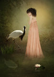 The sad girl and the crane Royalty Free Stock Photo