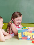 Sad girl crying in kindergarten Royalty Free Stock Images