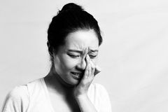 Sad girl crying. Portrait of pretty girl crying desperately, black and white style Stock Photos