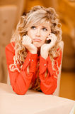 Sad girl with curly hair stock image