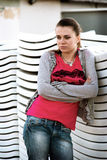 Sad girl. Depressive young woman in a red T-shirt Royalty Free Stock Photo