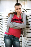 Sad girl. Depressive young woman in a red T-shirt Stock Image