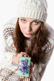 Sad girl disappointed with her small xmas present Stock Image