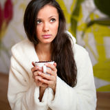 Sad girl drinking coffee Royalty Free Stock Images