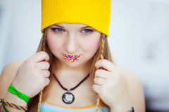 The sad girl with easter candies on lips Stock Photography