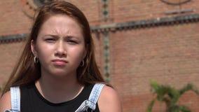 Sad Girl Feeling Agitated. A young teen hispanic girl Stock Photos