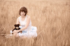 The sad girl in the field Royalty Free Stock Images