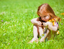 A sad girl is on the field Royalty Free Stock Image