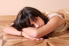 Sad girl on floor Stock Image