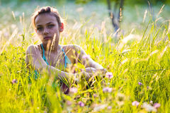 Sad girl in garden royalty free stock photos