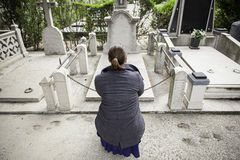 Sad girl grave. Sad girl in cemetery grave, religion Stock Photography