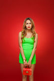 Sad girl in a green dress in the style of pin-up, isolated on a Stock Photos