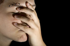 Sad girl with hand on her face Stock Photos
