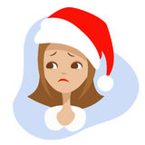 Sad girl in the hat of Santa Claus. Royalty Free Stock Image