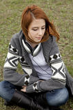 Sad girl with headphones Royalty Free Stock Photo