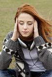 Sad girl with headphones Royalty Free Stock Image