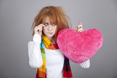 Sad girl with heart. St. Valentine Day Stock Photography