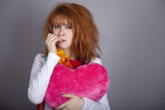 Sad girl with heart. St. Valentine Day Stock Photos