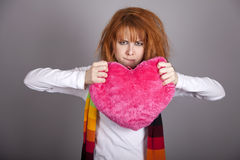 Sad girl with heart. St. Valentine Day Royalty Free Stock Images