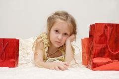 Sad girl with her gifts Stock Photography