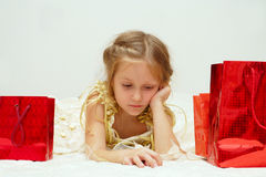 Sad girl with her gifts Royalty Free Stock Photo