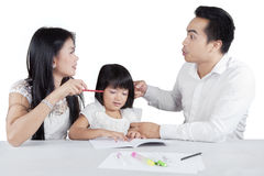Sad girl with her parents quarreling Stock Photography