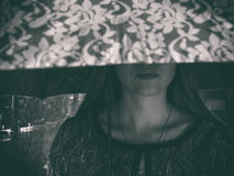 The sad girl hid her eyes under the umbrella. Night street and it`s raining Stock Image