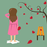 Sad girl hold red broken heart. Royalty Free Stock Image