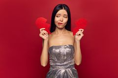 Free Sad Girl Holding Big Broken Red Heart. Valentine`s Day And Love Concept, Divorce, Alone, Single. Royalty Free Stock Image - 138279236